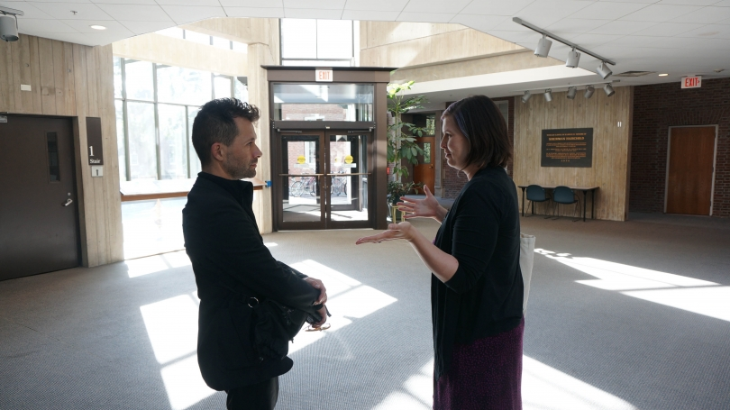 Jacob Kirkegaard (left) and Amelia Kahl (right) discuss the Fairchild atrium as a possible site for his Resonant Spaces project in April 2017.