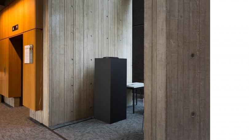 Custom-built speaker near elevator on the first floor of Fairchild Physical Sciences Center.