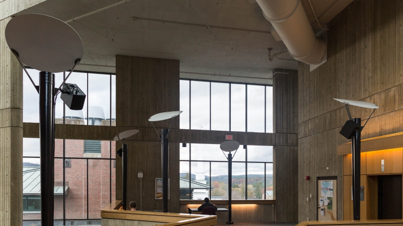 View of three of the four speakers mounted on existing light poles on the fourth floor.