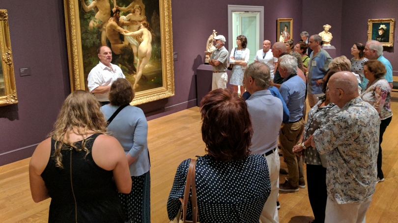 Members of the Lathrop Fellows group listening to Hood Director John Stomberg at the Clark Art Institute.