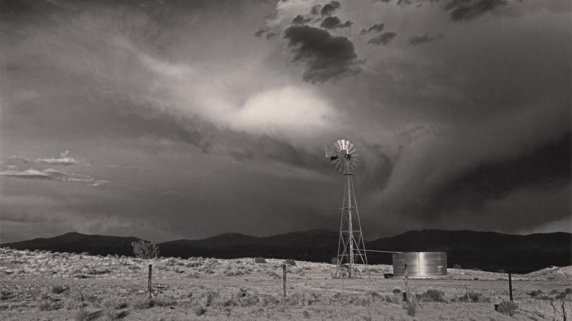 Storm clouds over a wind turbine.