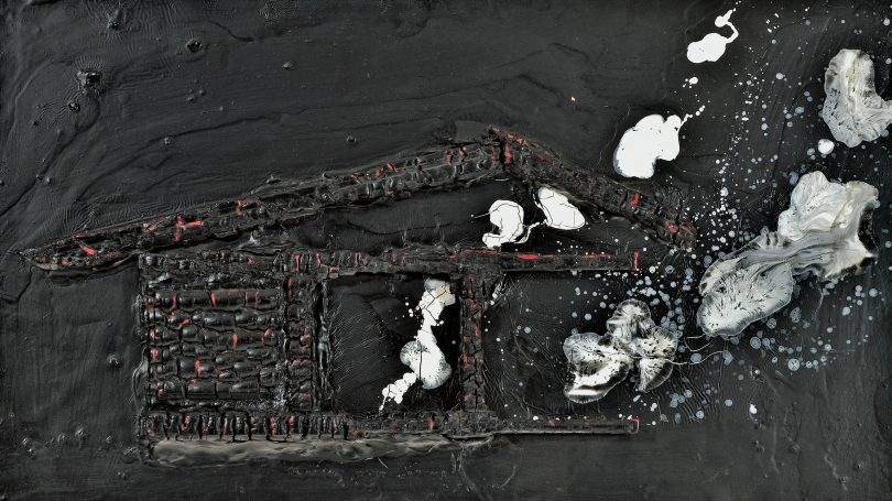 The outline of a house is on a black textured background, which looks like tar. The outline of the house is made of burnt wood scraps and white acrylic paint is poured on the surface which looks like smoke rising from the house.