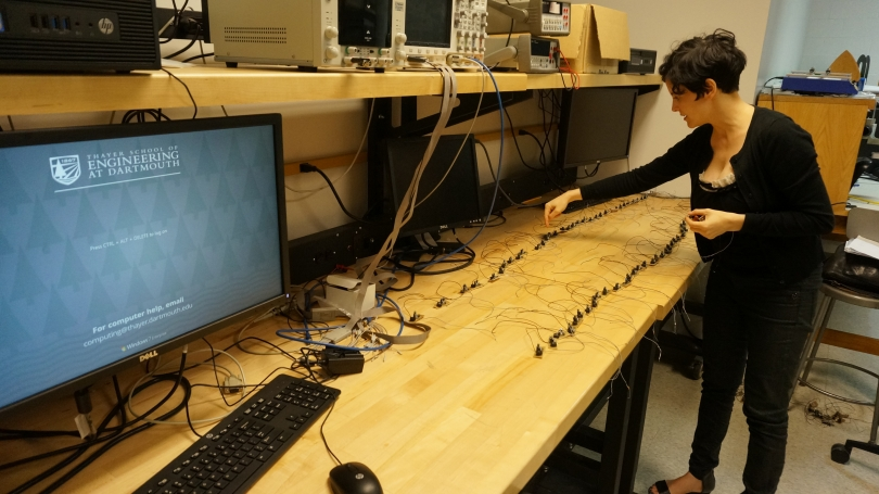Laura Maes lays out the handmade circuits for Spikes in a Thayer School of Engineering lab.