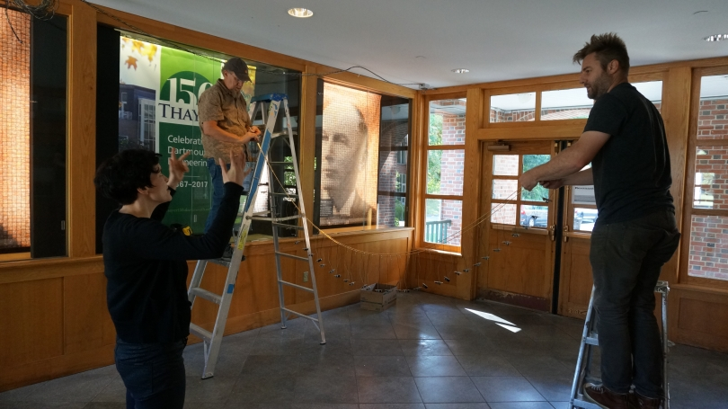 Laura Maes directs Hood preparators John Reynolds and Matt Zayatz in installing Spikes.