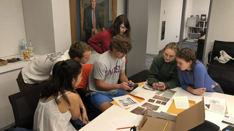 Museum Club members play the Assyrian Relief Escape Room Challenge during a weekly meeting.