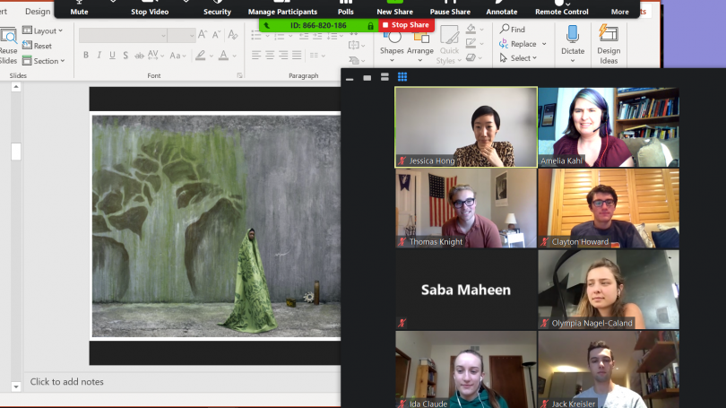 A zoom window with students, staff, and a painting of a figure wearing a green patterned cloth against a gray wall with the outline of a tree.