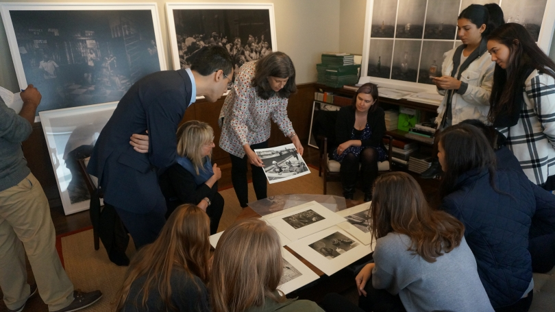 Dartmouth students participating in the spring 2017 session of Museum Collecting 101 review potential photographs to acquire for the Hood's collection.