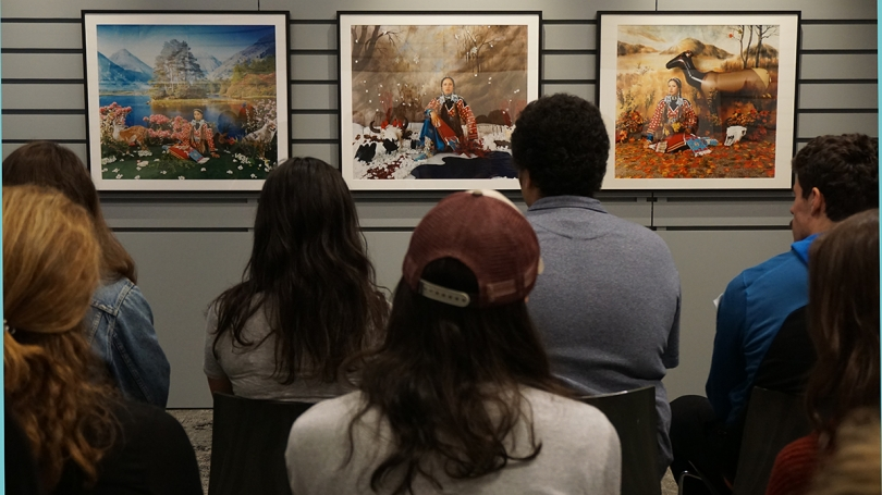 "Students view three prints from Wendy Red Star's ""The Four Seasons"" in the Bernstein Center for Object Study."