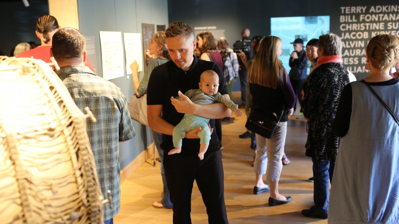 Thomas Mader, Christine Sun Kim's partner, with their daughter at the Resonant Spaces symposium
