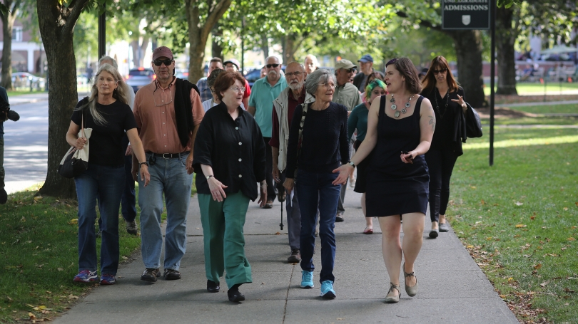 Amelia Kahl (right) speaks with visitors, including Dartmouth faculty members, during the symposium walking tour.