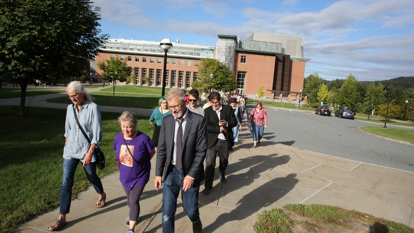 Hood Museum of Art Head of Exhibitions Design and Planning Patrick Dunfey (right) leads the symposium walking tour away from Bill Fontana's MicroSoundings.