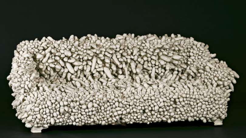 Yayoi Kusama, Japanese-American, born 1929, Accumulation II, 1962, sewn stuffed fabric, plaster, paint, and sofa frame. Hood Museum of Art, Dartmouth: Gift of Mr. and Mrs. Harry L. Tepper; S.974.374.