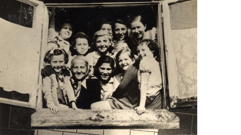 Stella Rein, the headmaster of the Łódź ghetto's high school, posing with young girls in 1941. United States Holocaust Memorial Museum: Courtesy of Arie Ben Menachem; 2005.163.