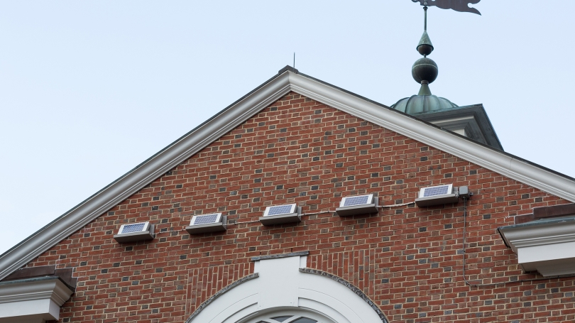 The five solar panels of Spikes mounted on the exterior of Cummings Hall, Thayer School of Engineering, Dartmouth College.