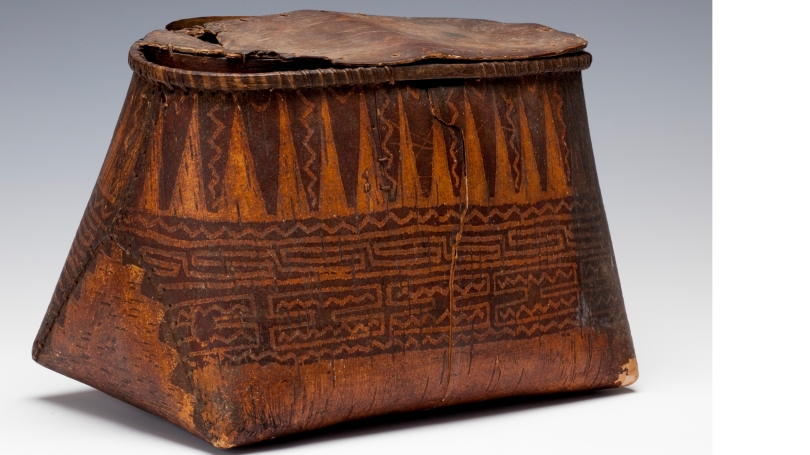 Unknown people (Woodlands), container depicting the cosmological universe and, on the underside, two thunderbirds, about 1800, Birch bark, wood, spruce root, twine (added later). Museum Purchase; 163.66.15194. Photo by Jeffrey Nintzel.