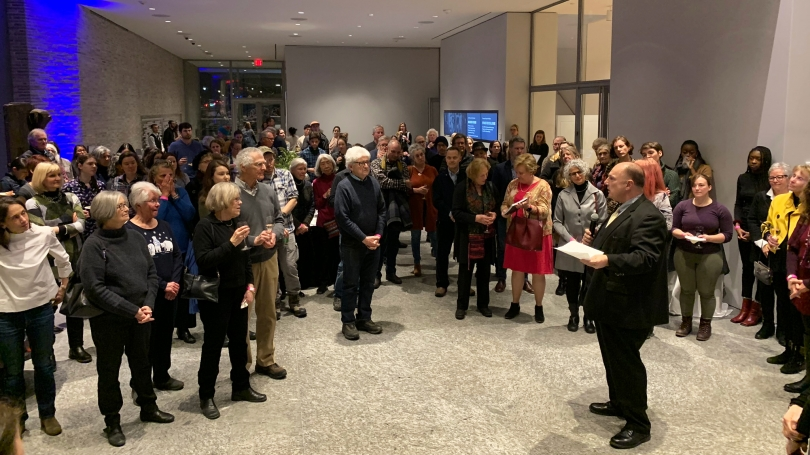 Director John Stomberg welcomes guests to the Winter Opening Reception in the Russo Atrium on January 16, 2020. Photoby Alison Palizzolo.