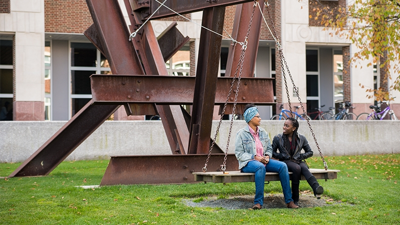 Students sitting on X-Delta by Mark Di Suvero