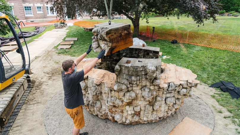 The sculpture being installed in its permanent place on campus.