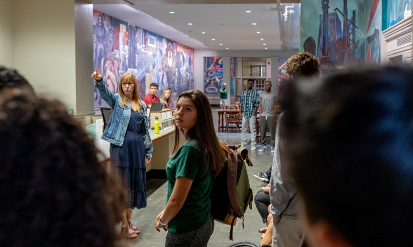 Professor Mary Coffey answers questions from '22s about the Orozco mural