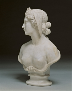 A white marble sculpture of a bust of a woman, who is meant to be medusa.