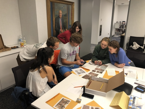 Museum Club members, from left, Donia Tung '22, Hadley Detrick '22, Adam Stein '23, Carson Riggs '23, Helen Horan '22, and Alice Crow '22 play the Hood's Assyrian Relief Escape Room Challenge.